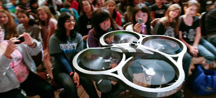 "A radio-controlled drone, dubbed ""Navy STEM Drone,"" flies near audience members before the Oh! Zone show at the 12th annual Science Technology Education Partnership Conference in Riverside, Calif., Oct. 26, 2011."
