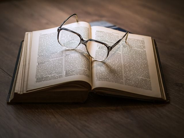 Glasses on books