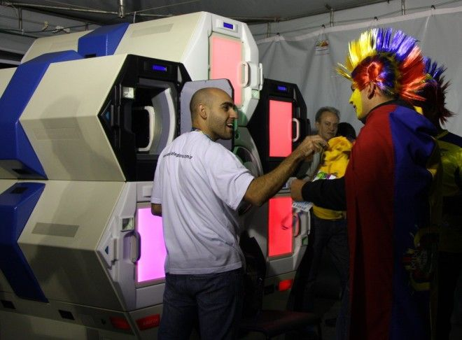 Fans at a World Cup game at Arena de Baixada stadium in Curitiba, Brazil use the Qylatron to go through security.