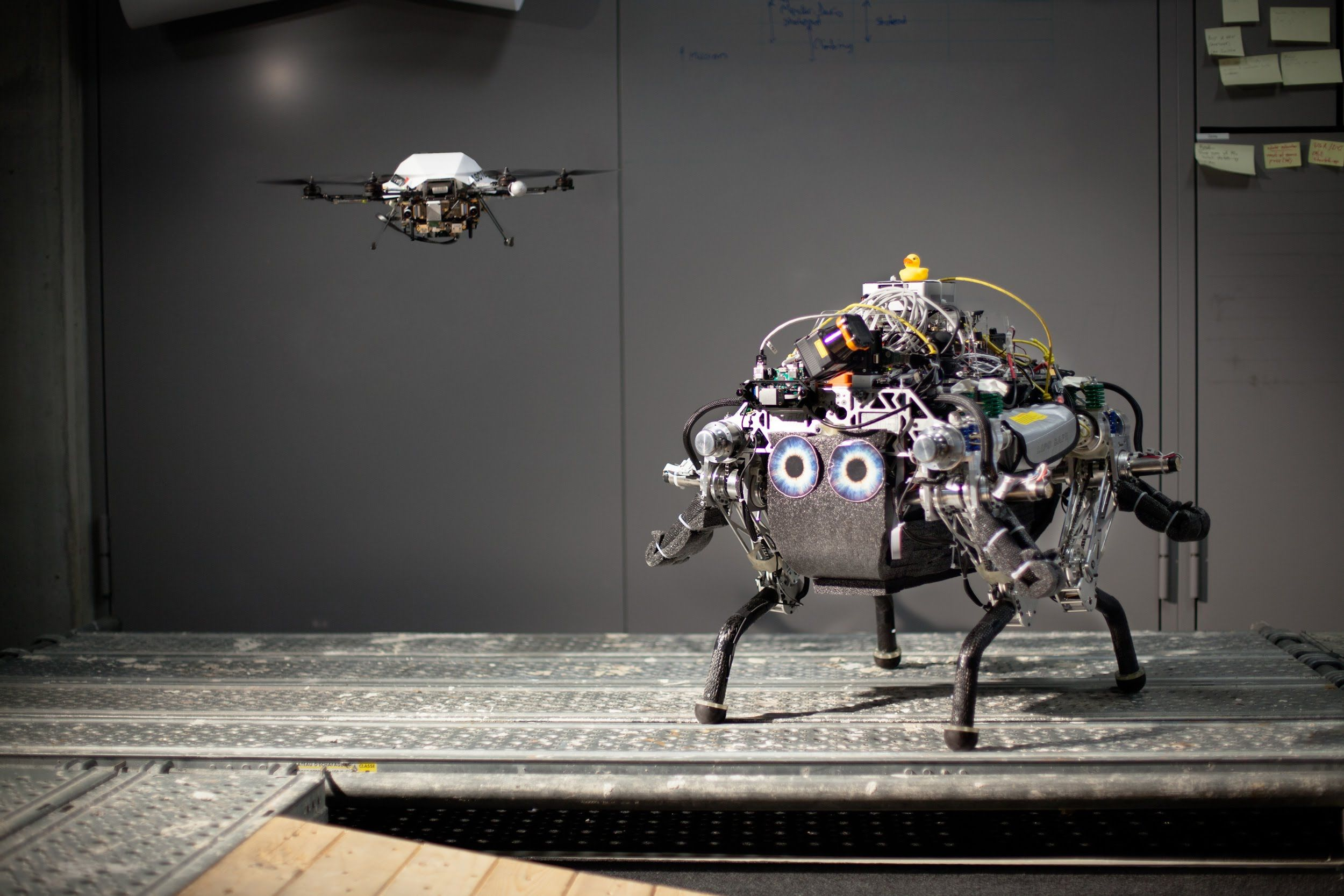 Walking Robot Uses Drone To Help Traverse Tricky Terrain Video